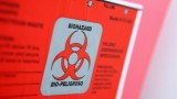 Angrily red container marked Biohazard